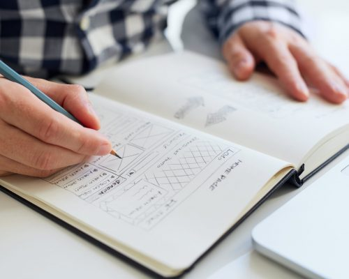 Close up of man sketching graphic sketch in office